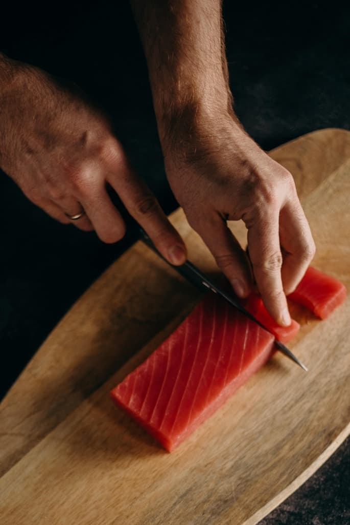 Chef Cutting Salmon With A Knife