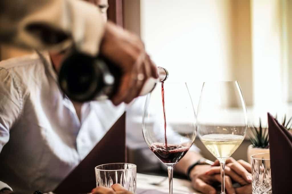 Waiter Serving Wine
