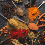 Mixture Of Spices On Spoons